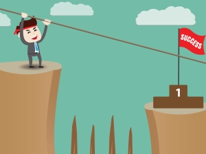 Businessman rope over cliff