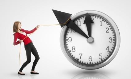 Woman pulling clock hands backwards